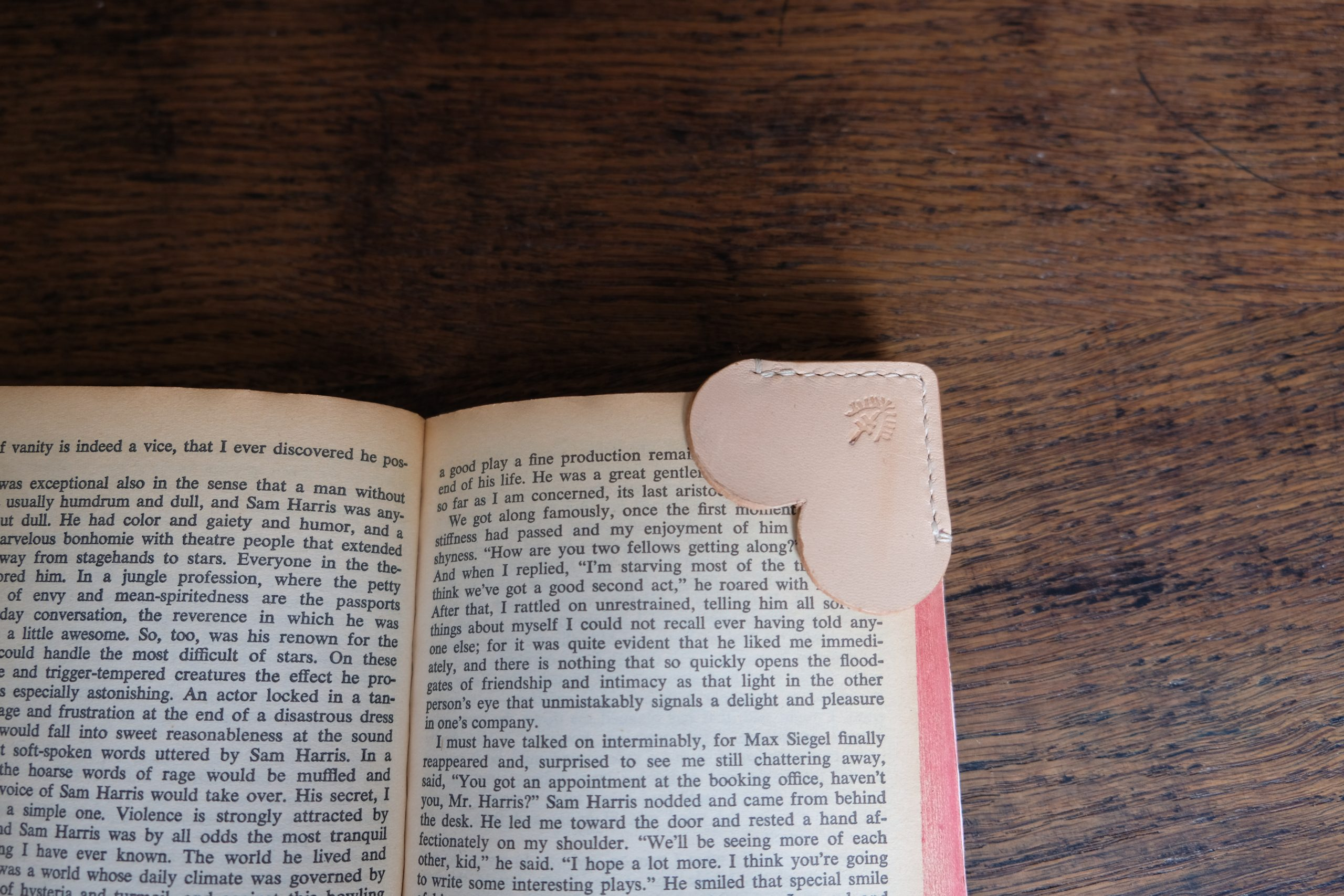 lerif designs love bookmark on a book corner with wood background