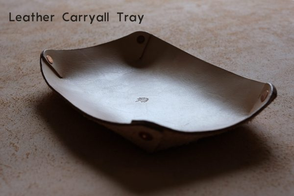 lerif designs leather carryall tray on a beige background