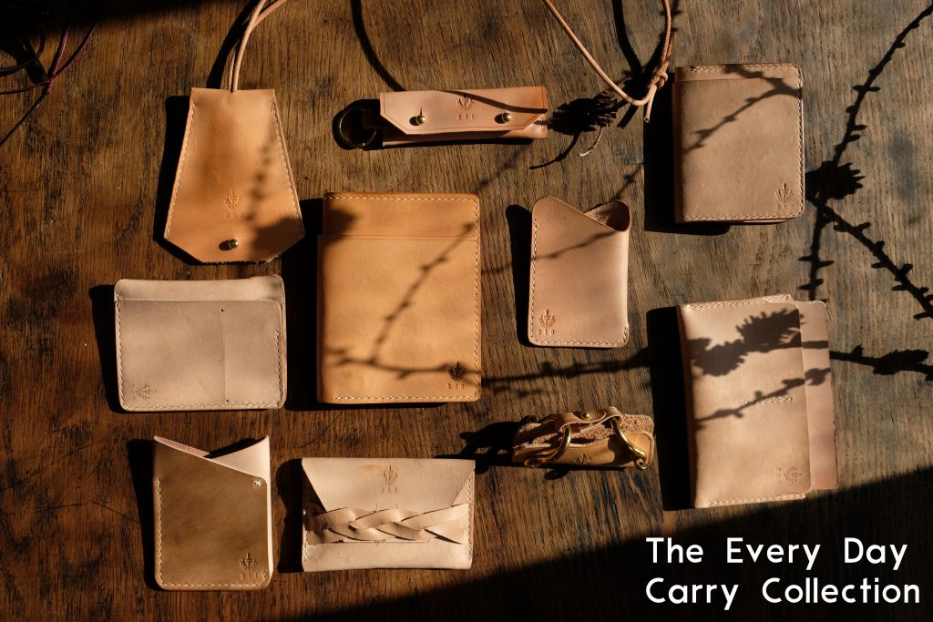lerif designs every day collection leather items on wood background