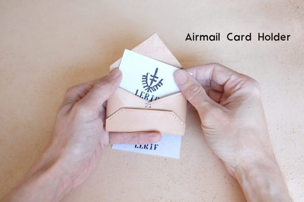 lerif designs leather airmail business card holder with brand card peeking out