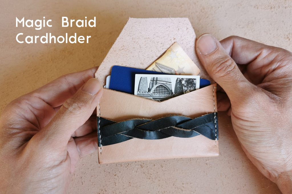 lerif designs magic braid cardholder in indigo and natural on beige background