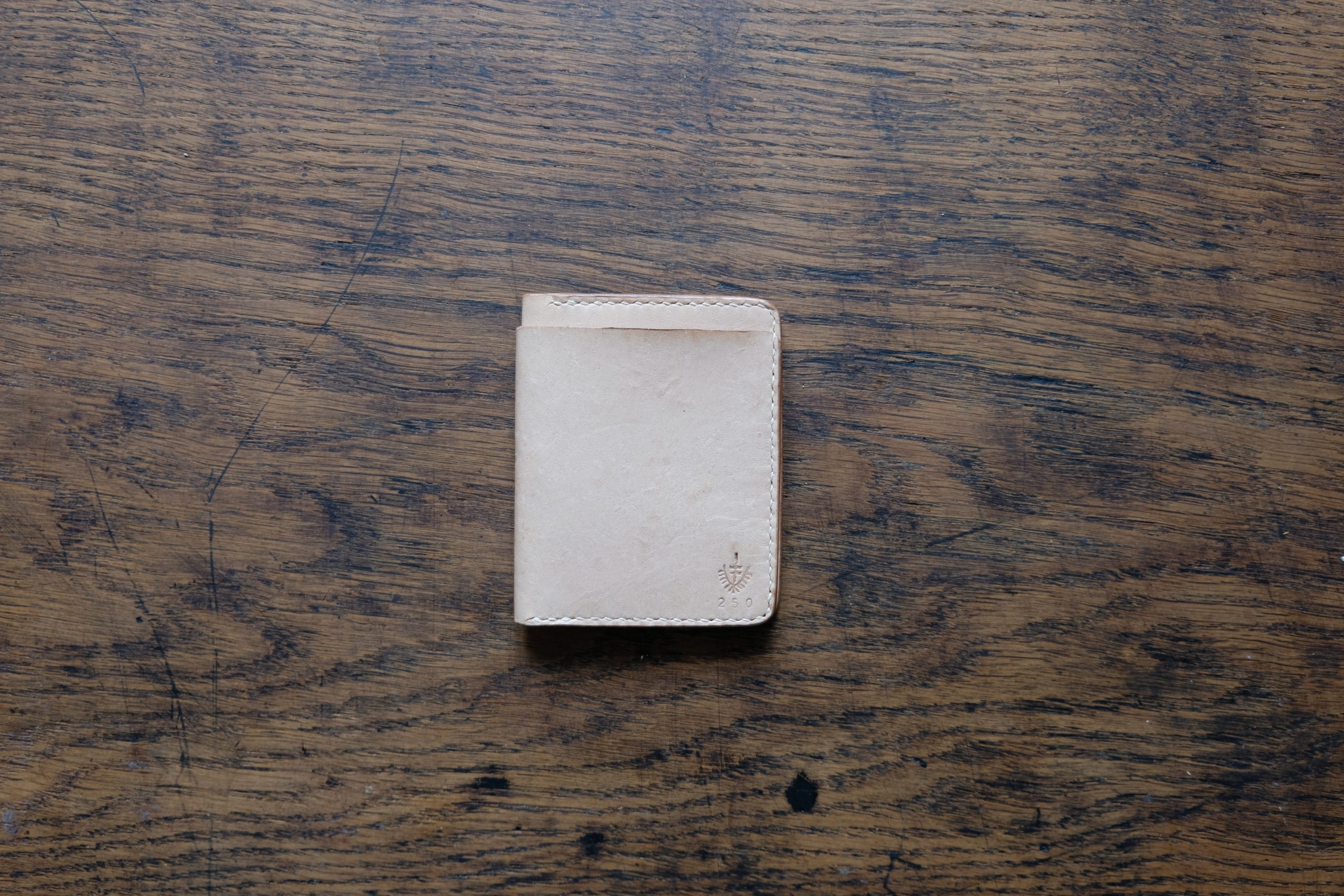 lerif designs small bifold leather wallet in natural on wood background