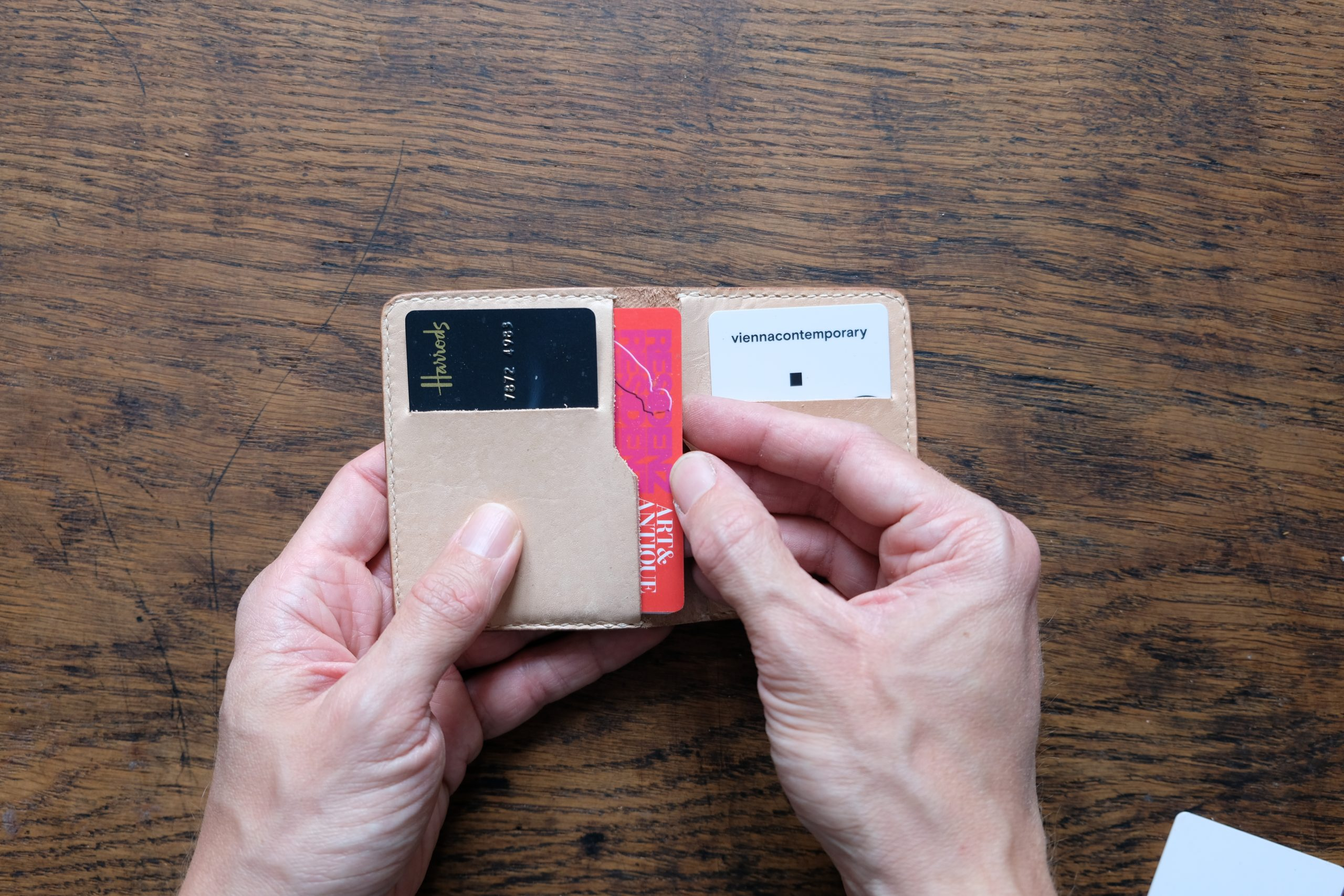 lerif designs small bifold leather wallet in natural on wood background demonstrating card pockets