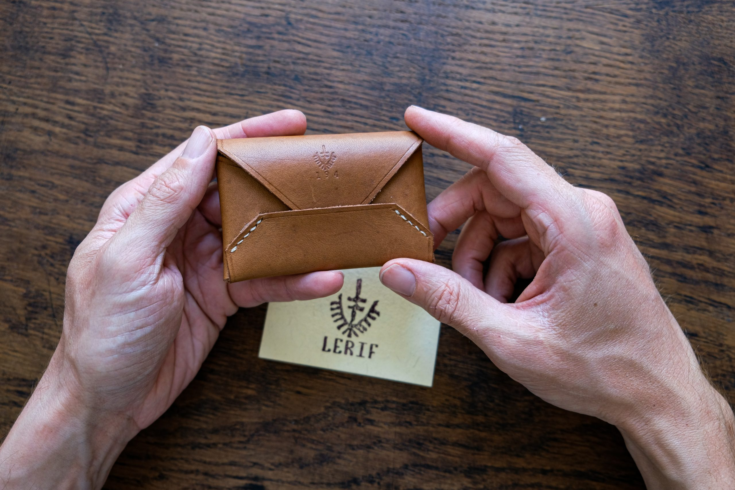 lerif designs leather airmail business card holder in walnut on wood background