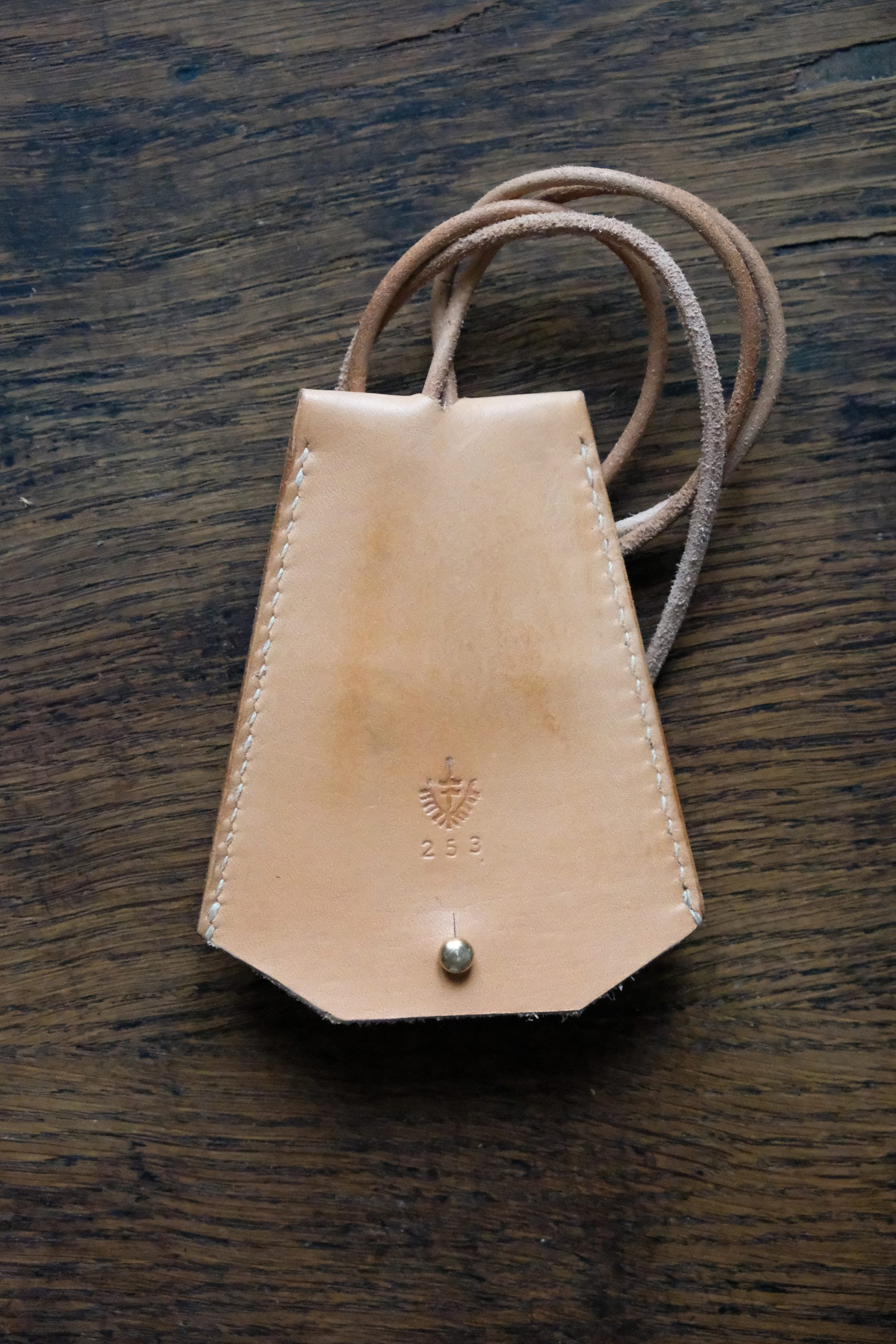 Lerif Designs leather bell key holder natural demo on wood background
