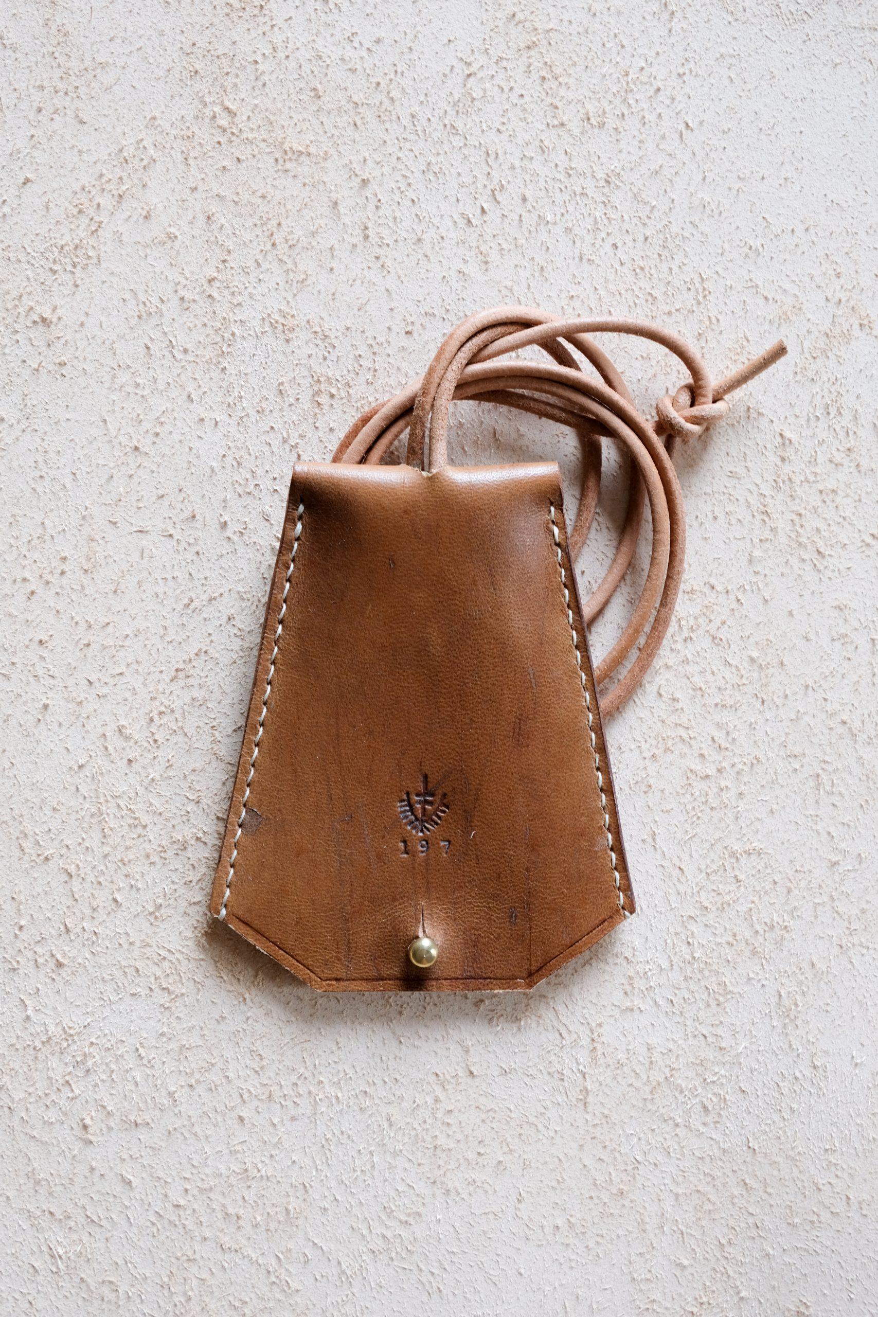 Lerif Designs leather bell key holder walnut demo on beige background