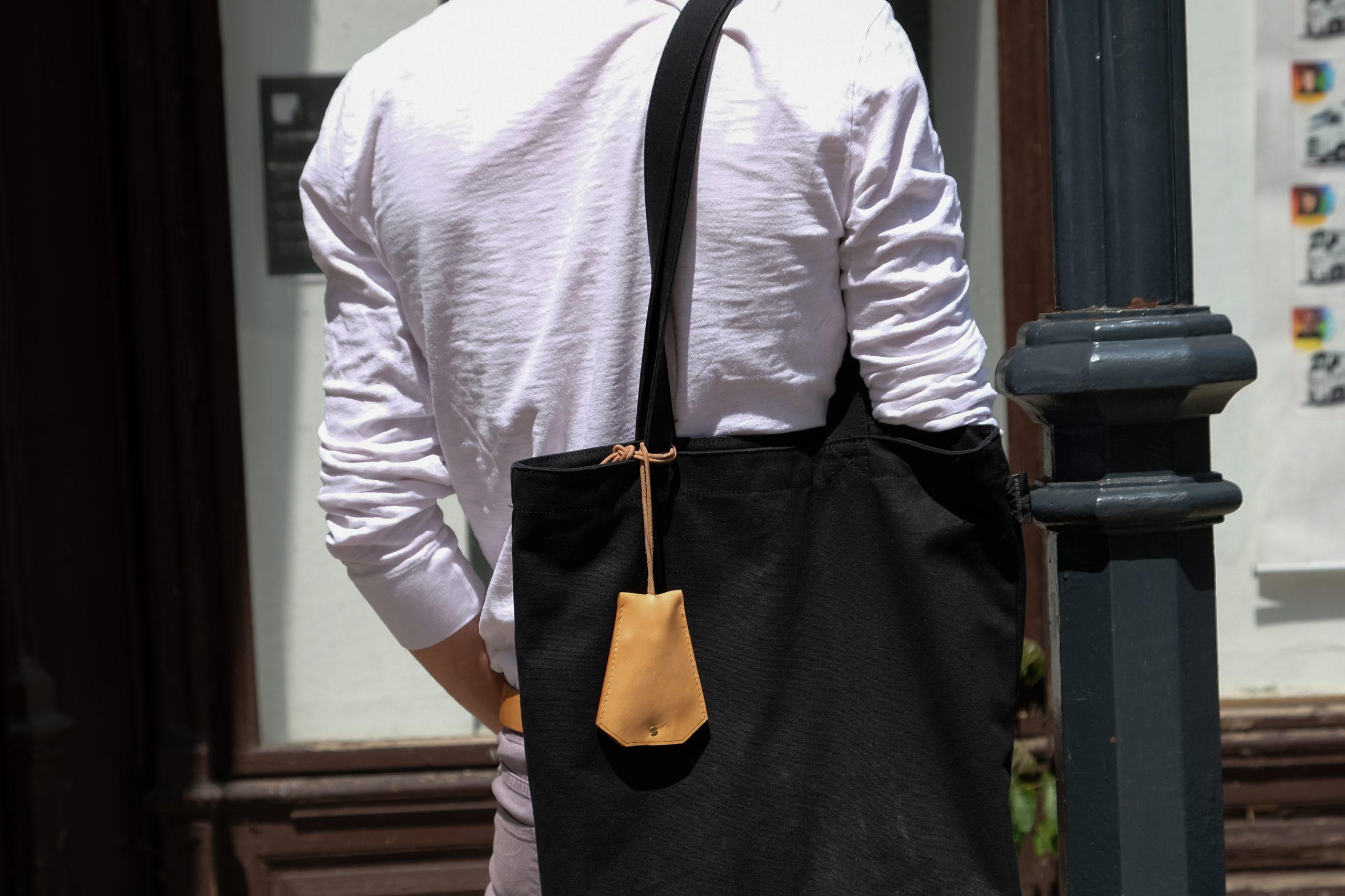 Lerif Designs leather bell key holder demo hanging on bag