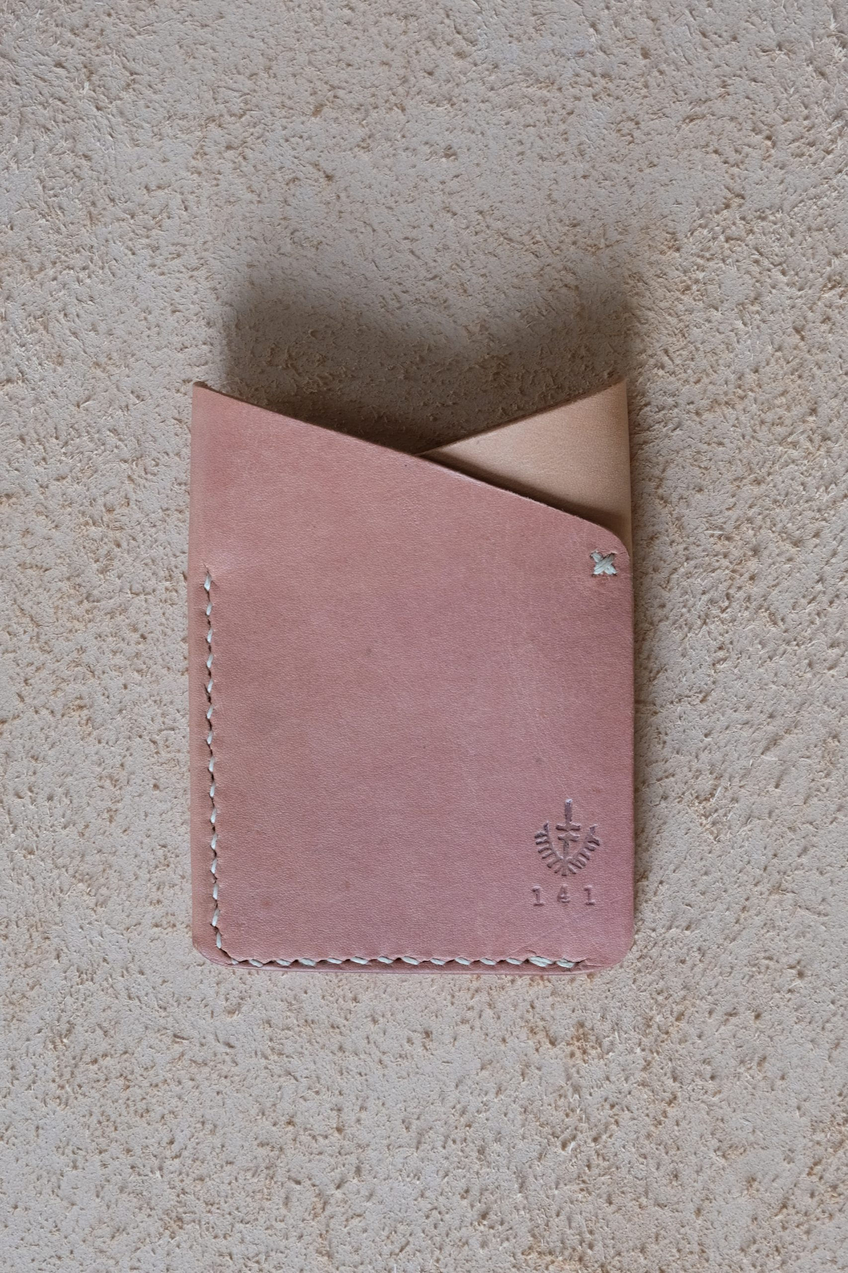 lerif designs leather fox ears cardholder in red beet on beige background