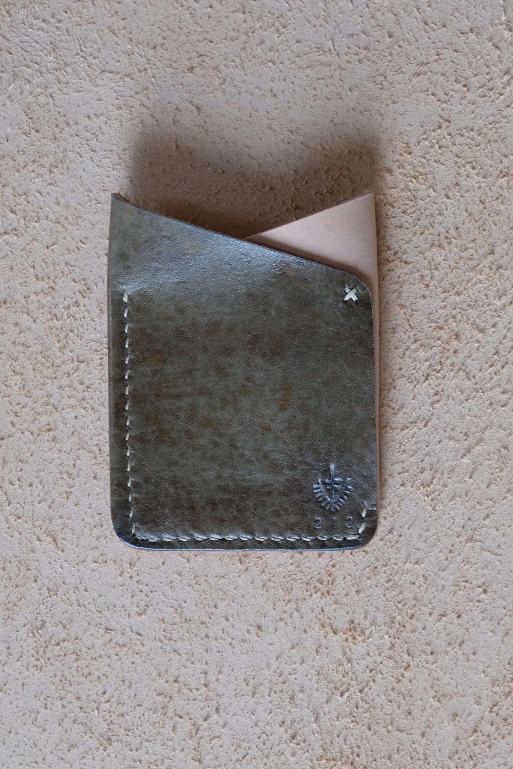 lerif designs leather fox ears cardholder in vinegaroon dye on beige backgroun