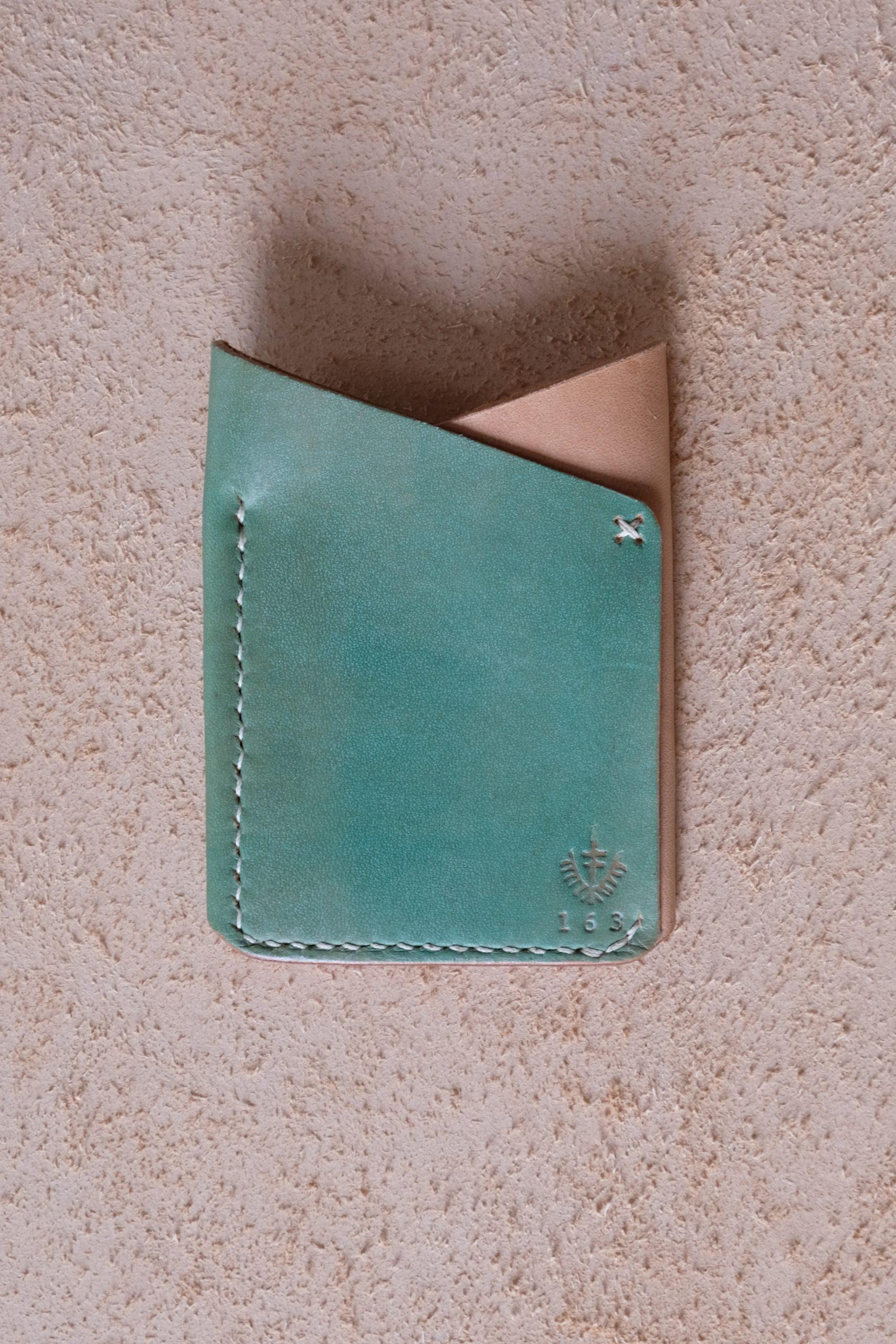 lerif designs leather fox ears cardholder in pistachio on beige backgroun