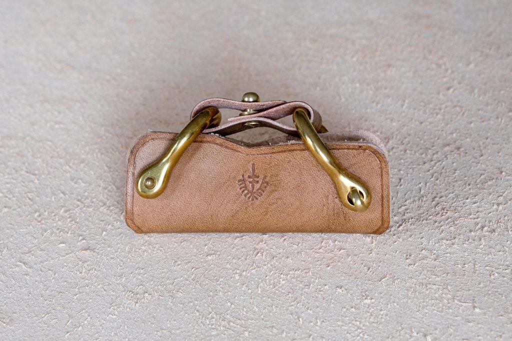 lerif designs leather horse buckle key holder walnut on beige background