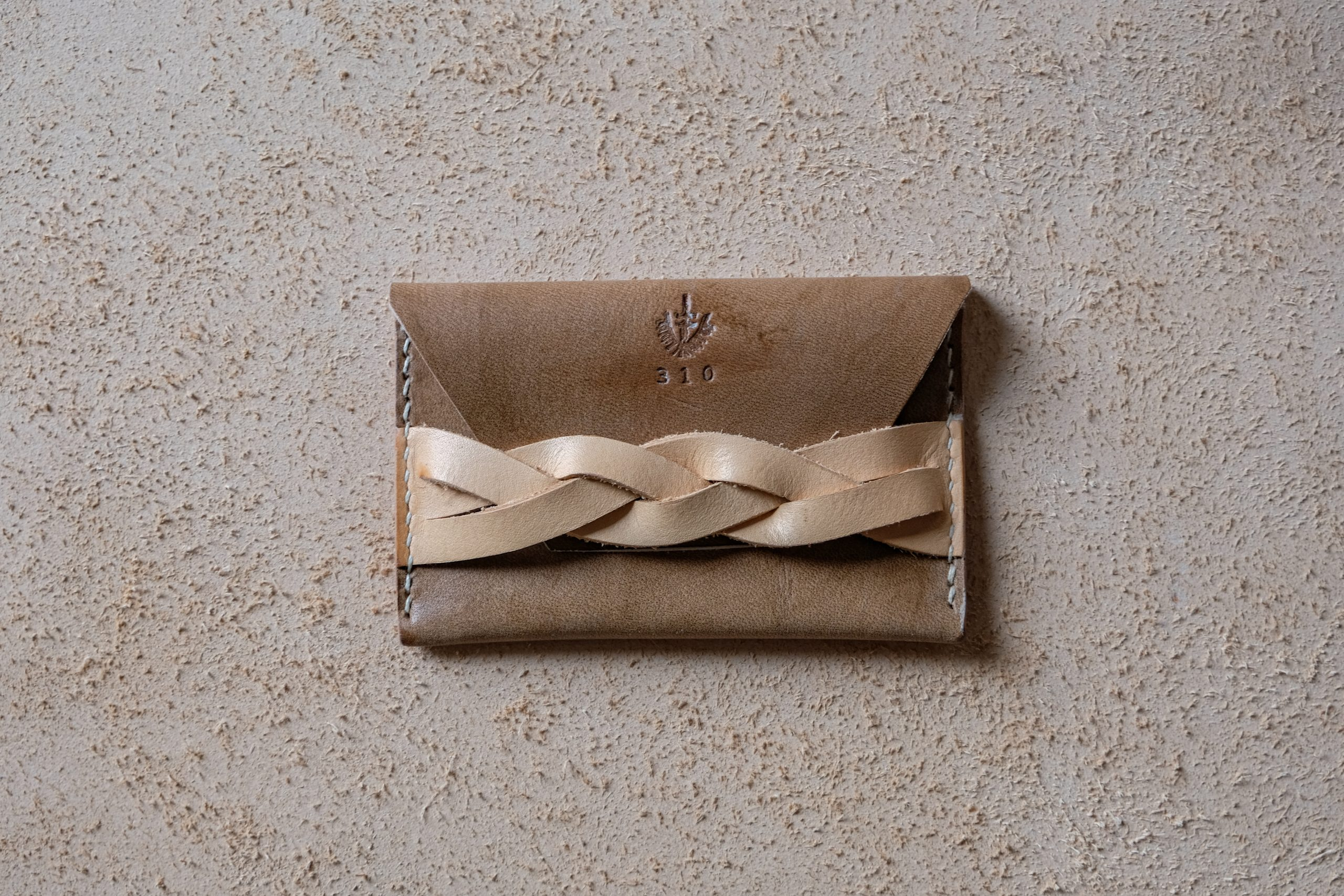 lerif designs leather magic braid cardholder walnut and natural on beige background