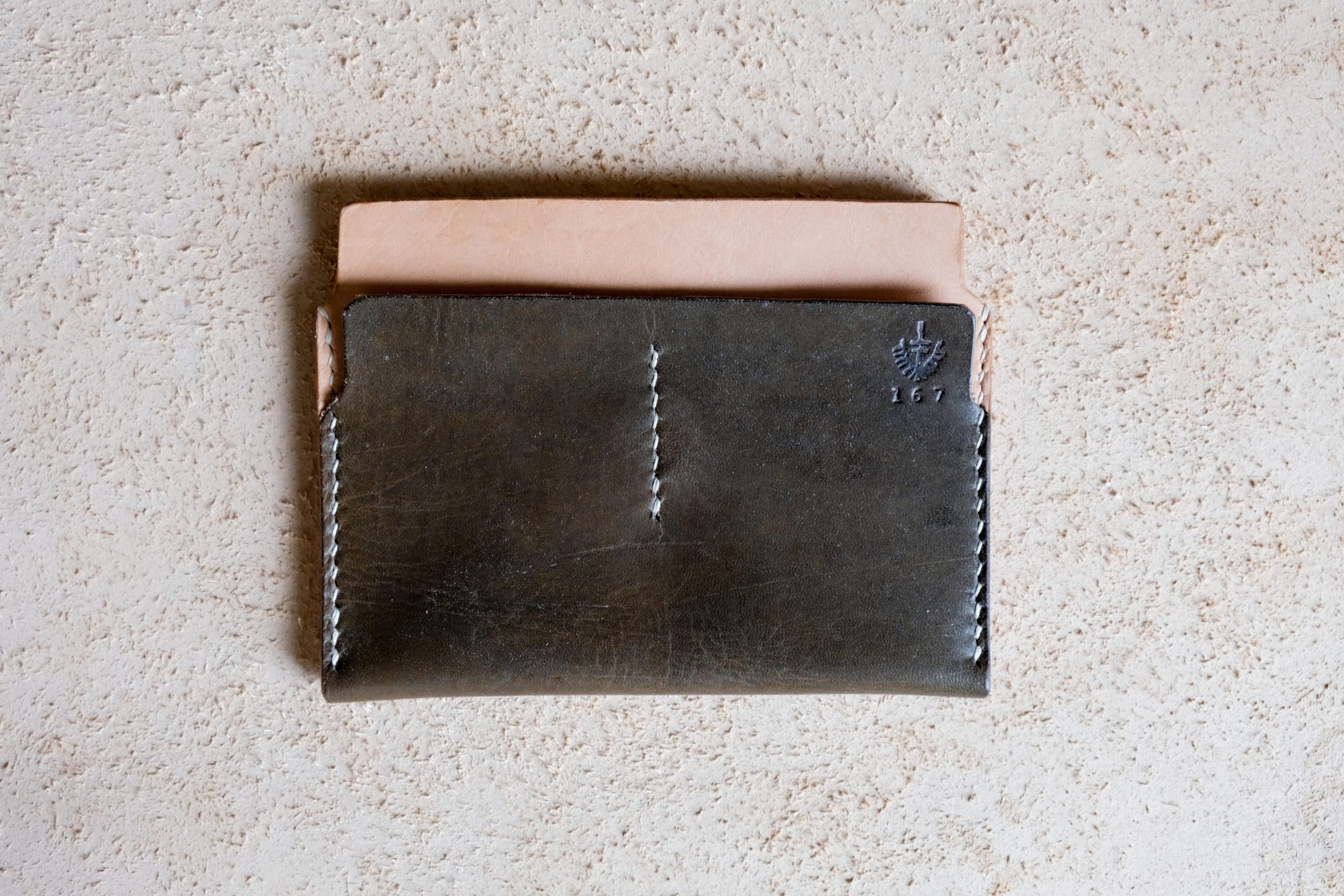 lerif designs sandwich leather wallet on beige background