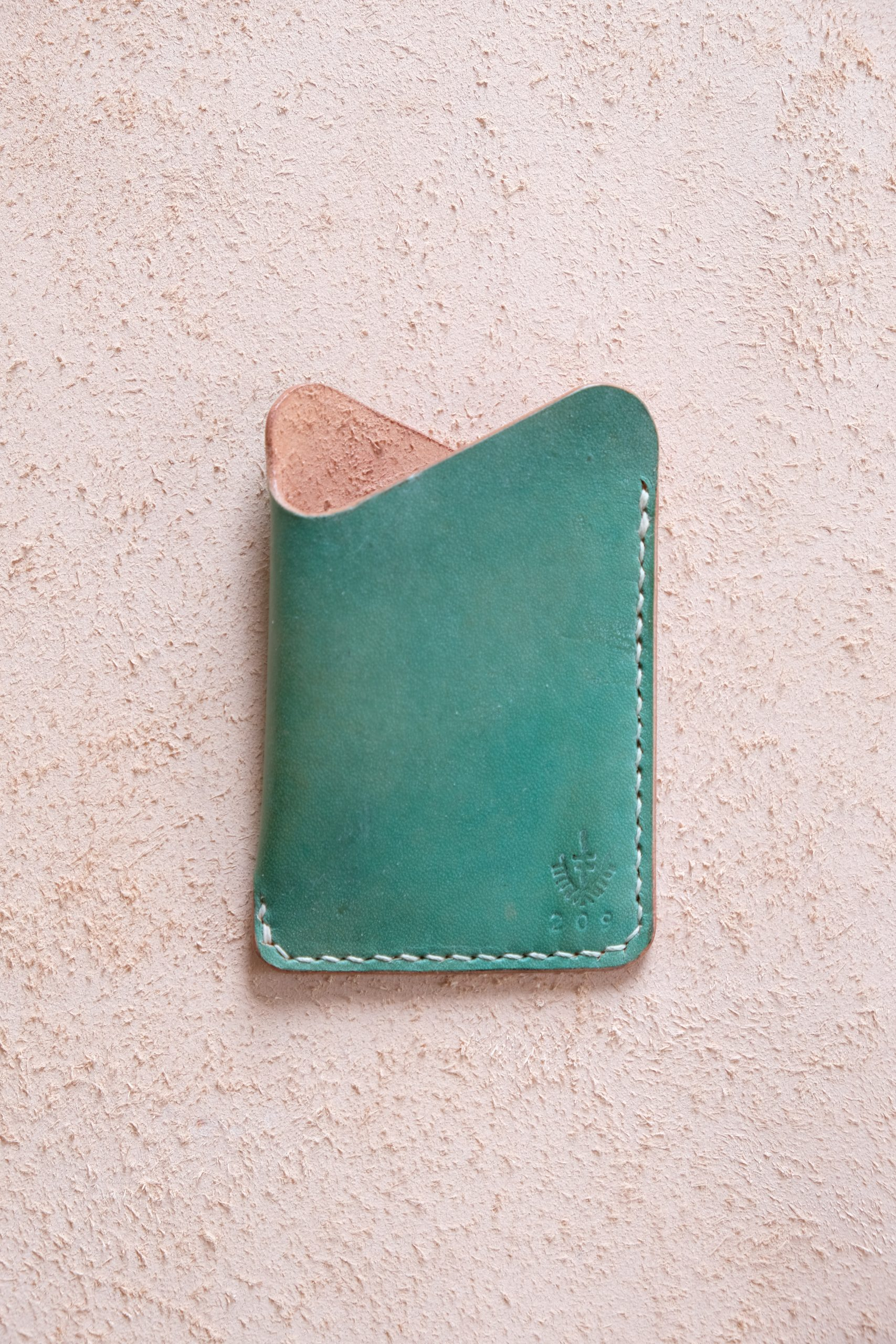 lerif designs leather wave cardholder pistachio on beige background
