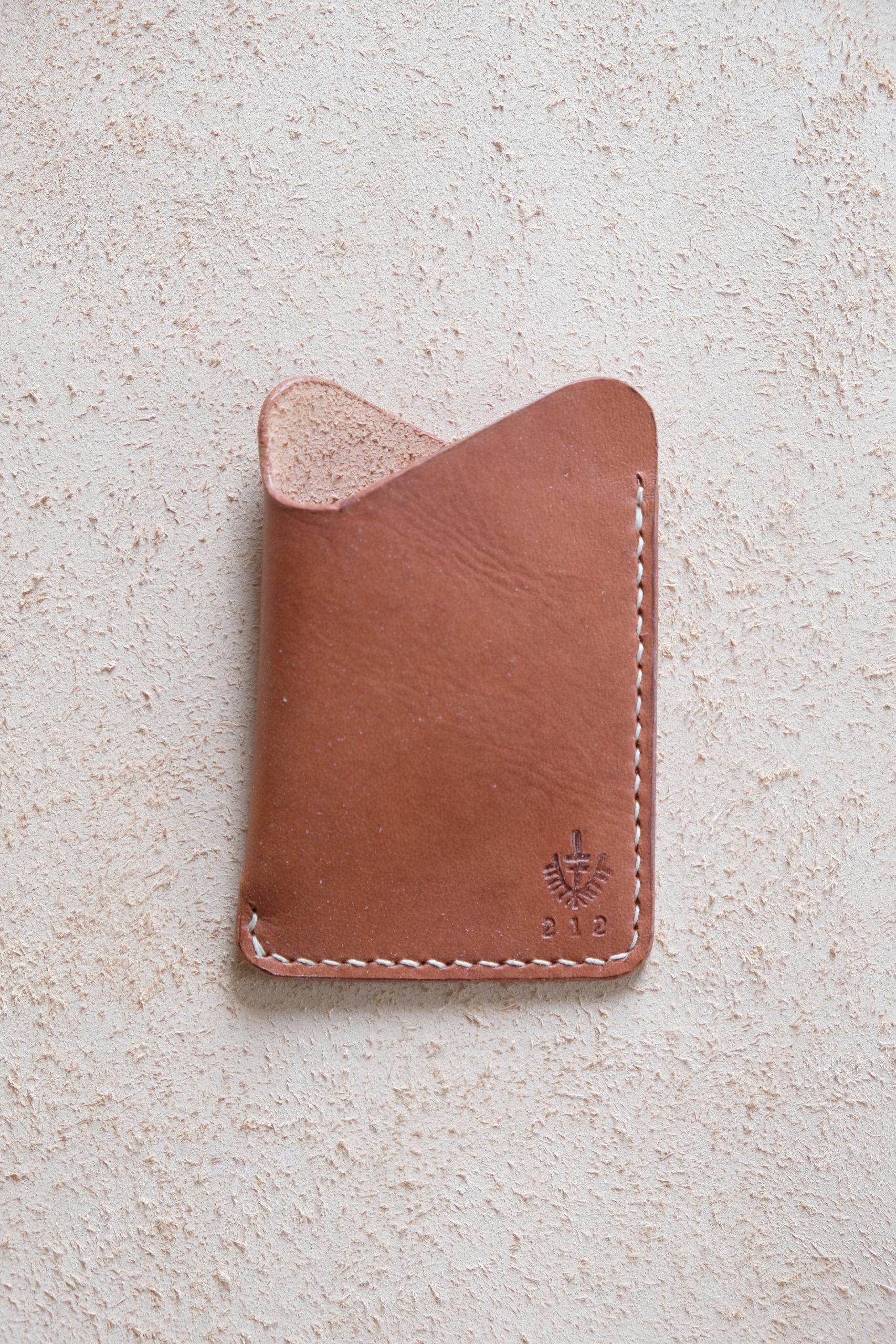 lerif designs leather wave cardholder burgundy on beige background