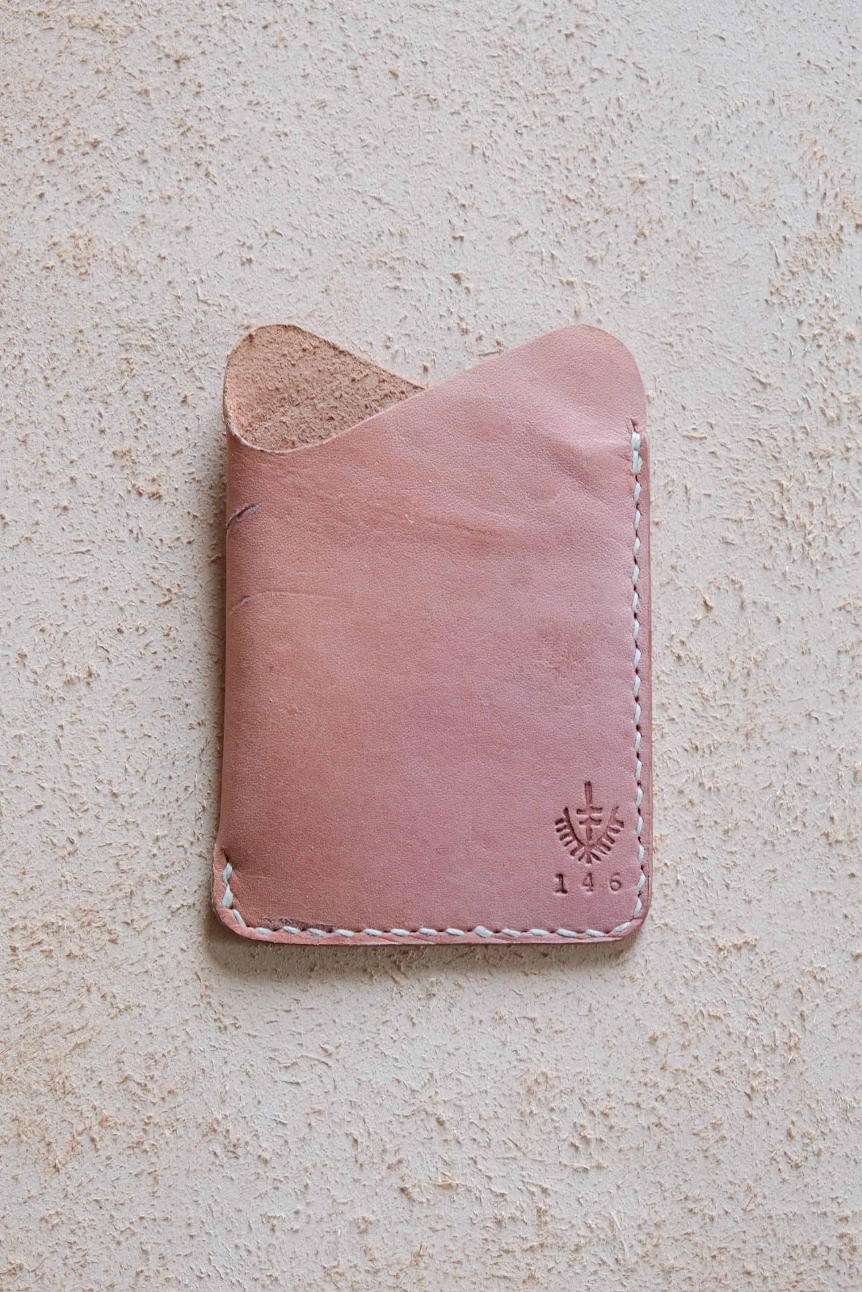 lerif designs leather wave cardholder beet on beige background