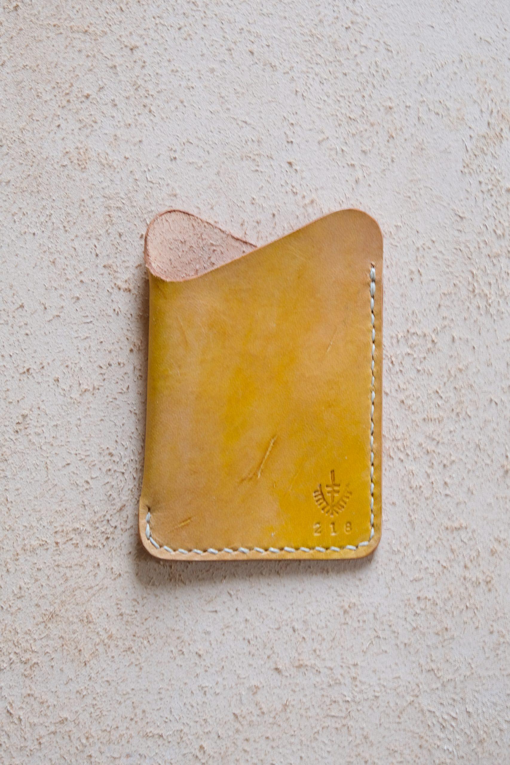 lerif designs leather wave cardholder turmeric on beige background
