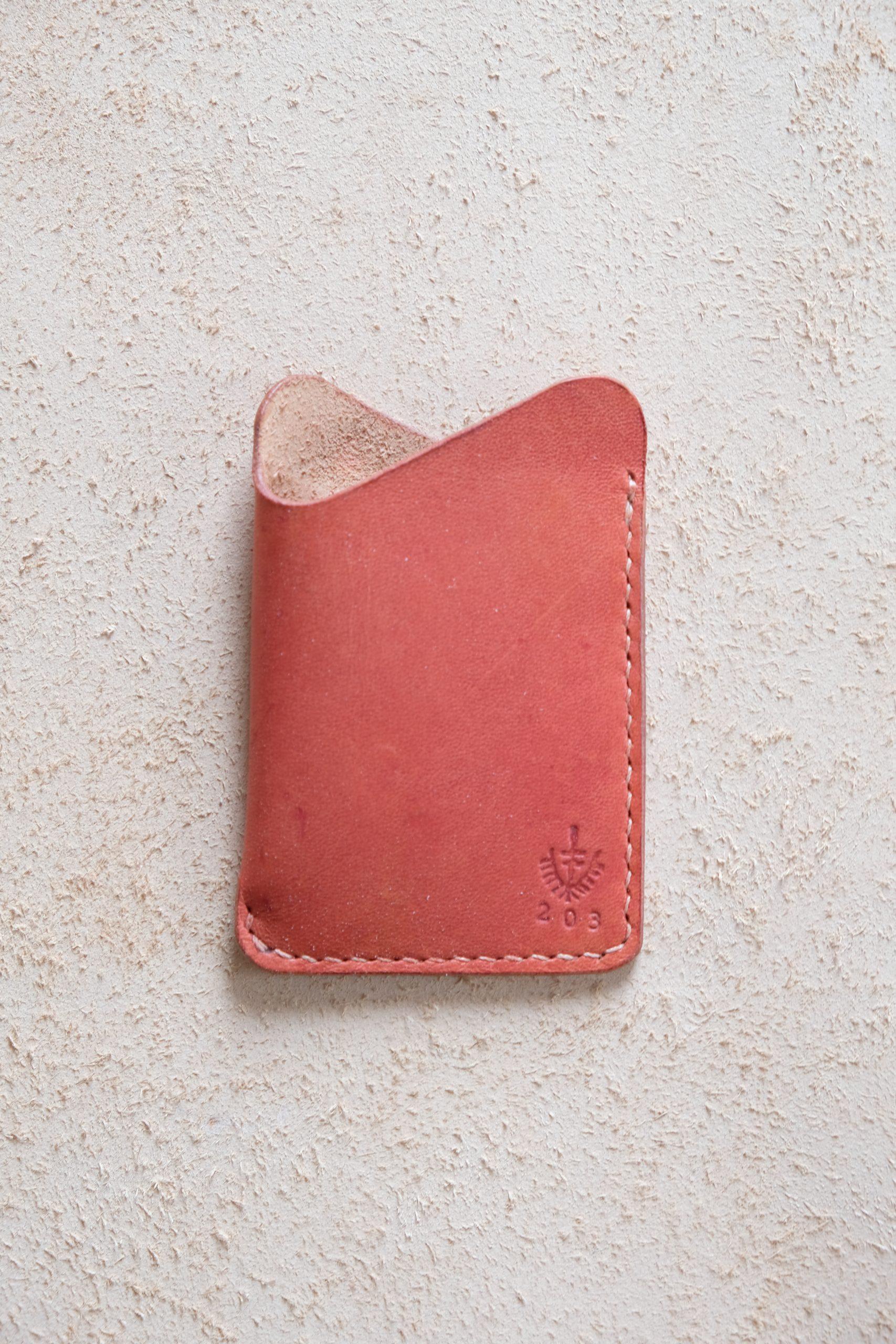 lerif designs leather wave cardholder pomegranate on beige background