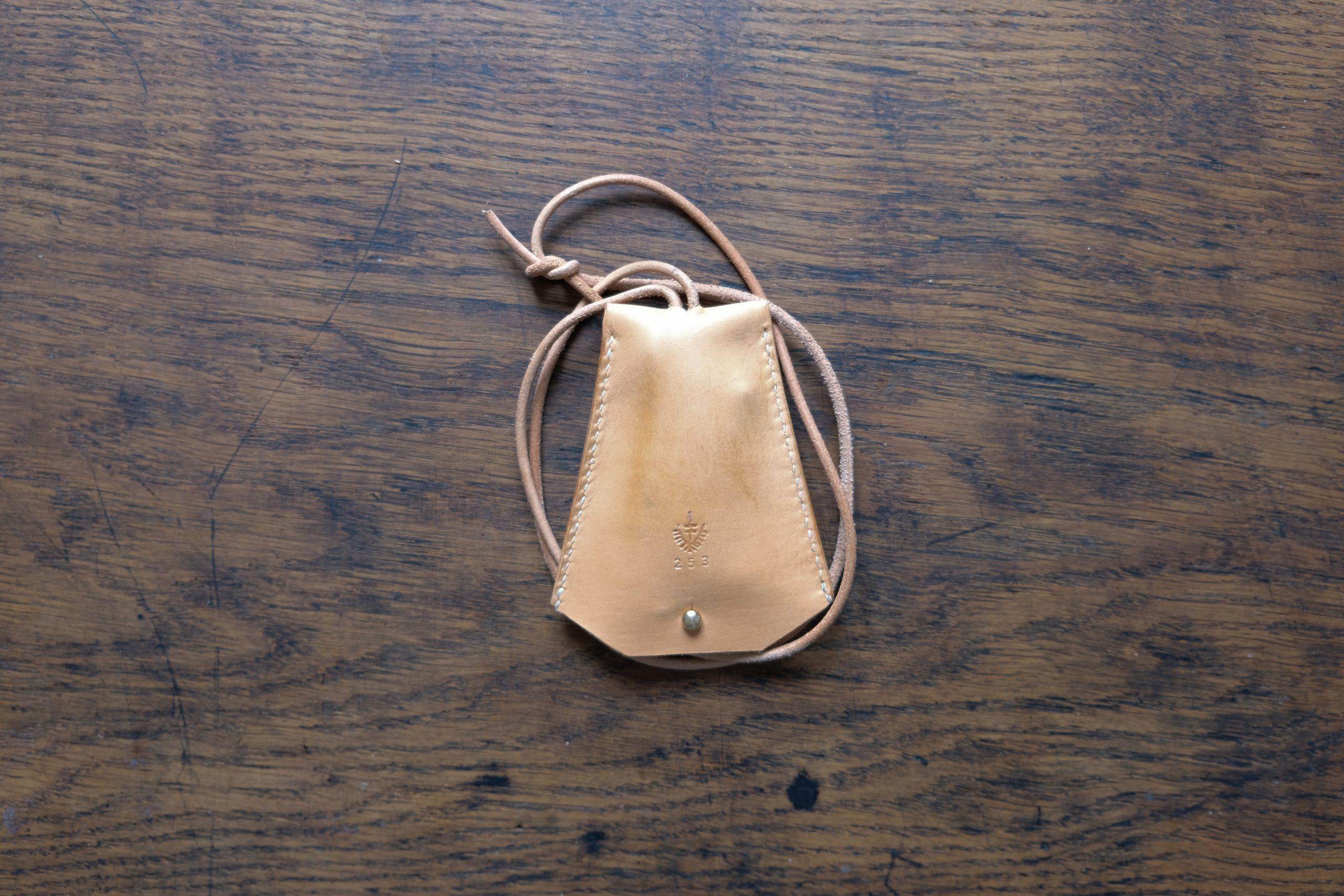 Lerif Designs leather bell key holder demo on wood background