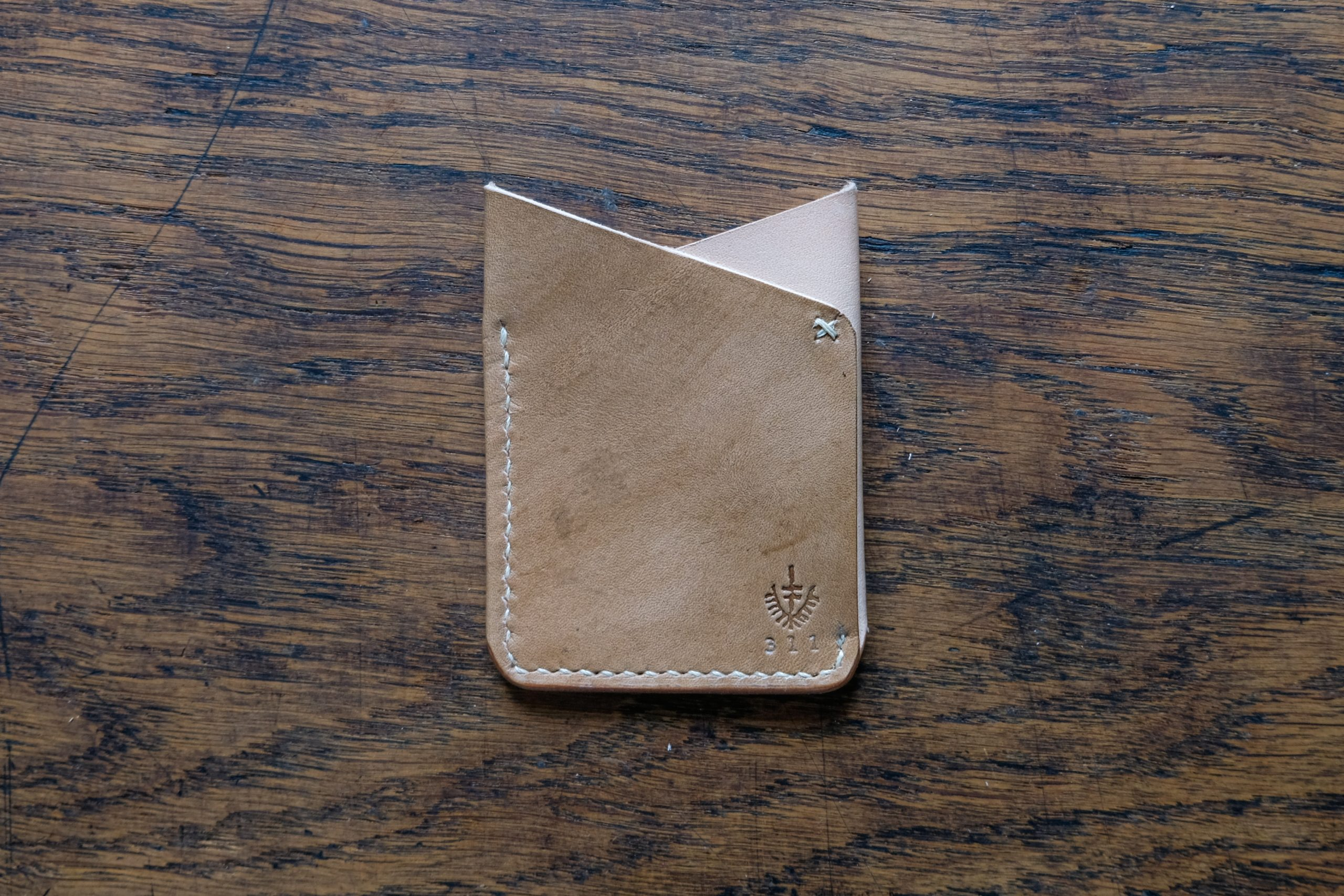 lerif designs leather fox ears card holder front demo on wood background