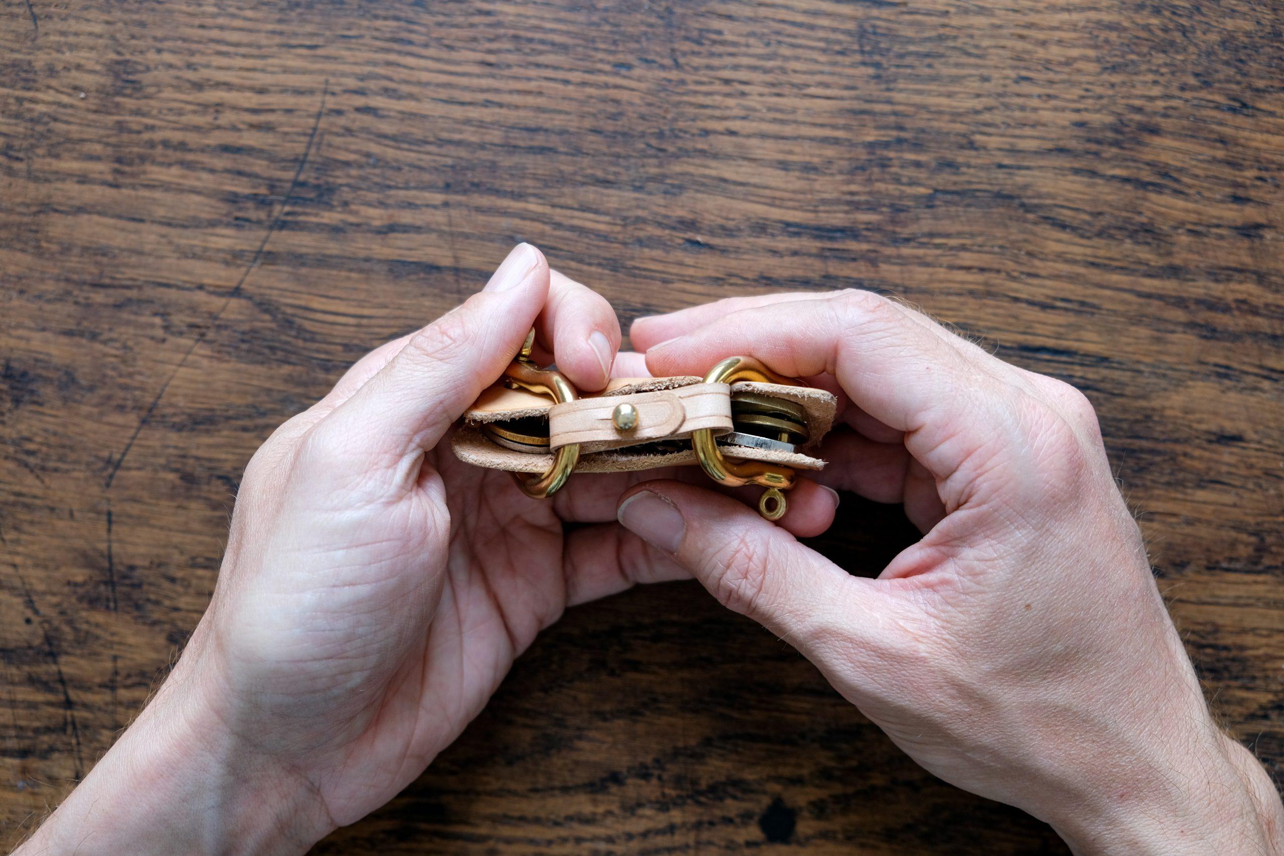 lerif designs leather horse buckle key holder demo hands on wood background