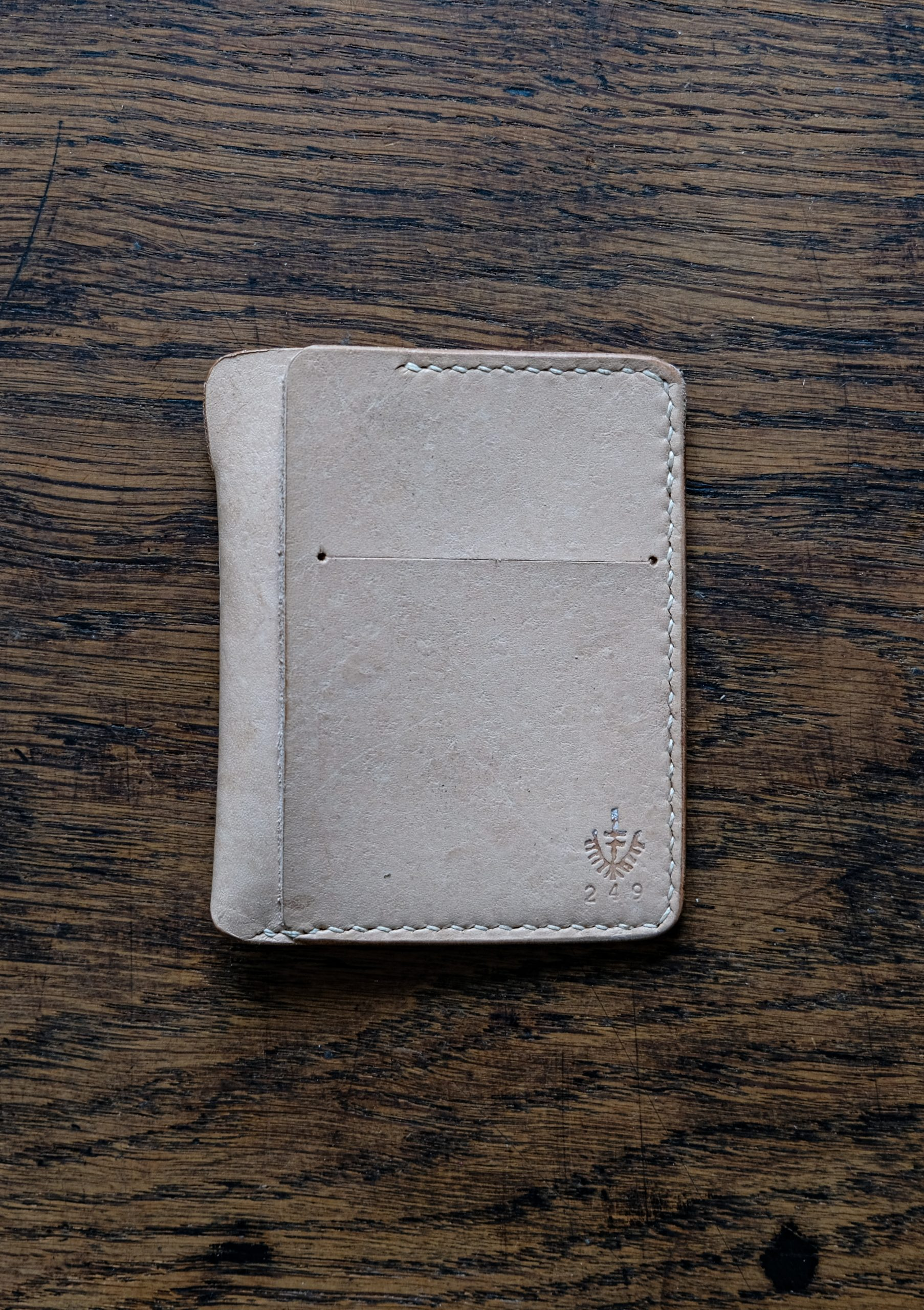 lerif designs Vale leather wallet in natural on wood background