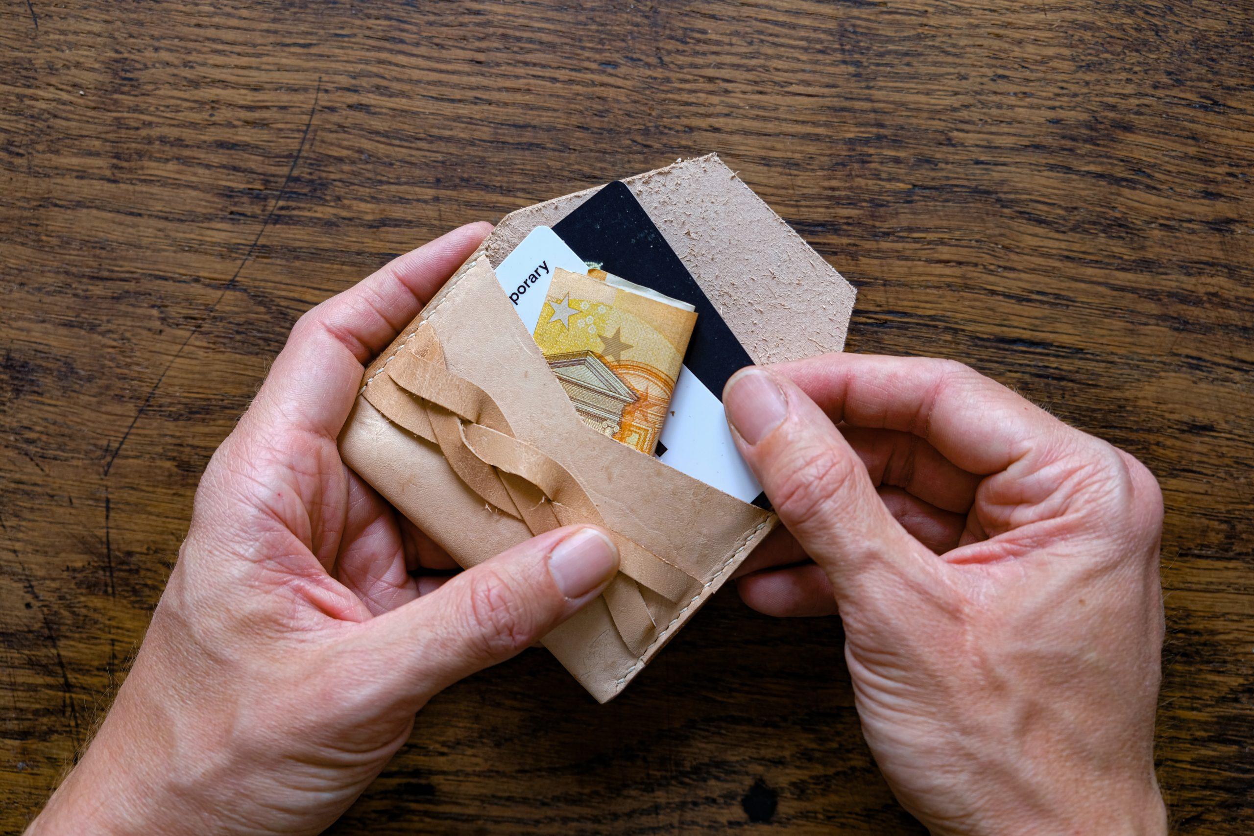 lerif designs leather magic braid cardholder hands demo on wood background