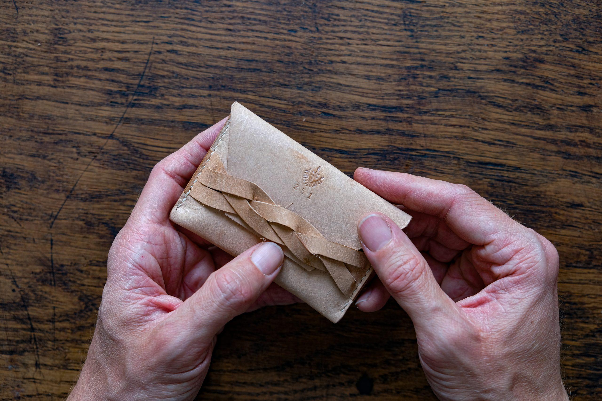 lerif designs leather magic braid cardholder demo on wood background