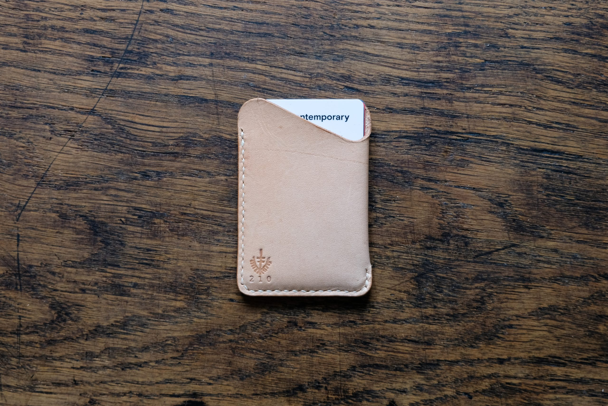 lerif designs leather wave cardholder demo with card on wood background