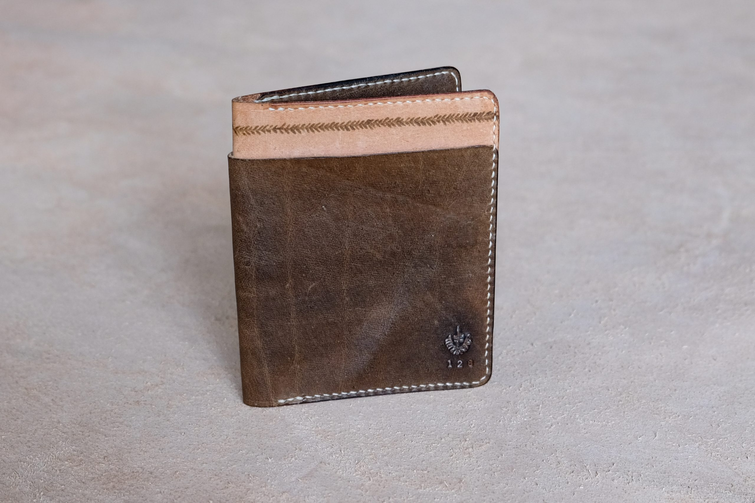 lerif designs large format leather bifold wallet in vinegaroon on beige background