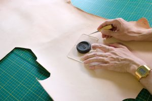 lerif designs leather demo hands working on vegetable tanned leather in atelier
