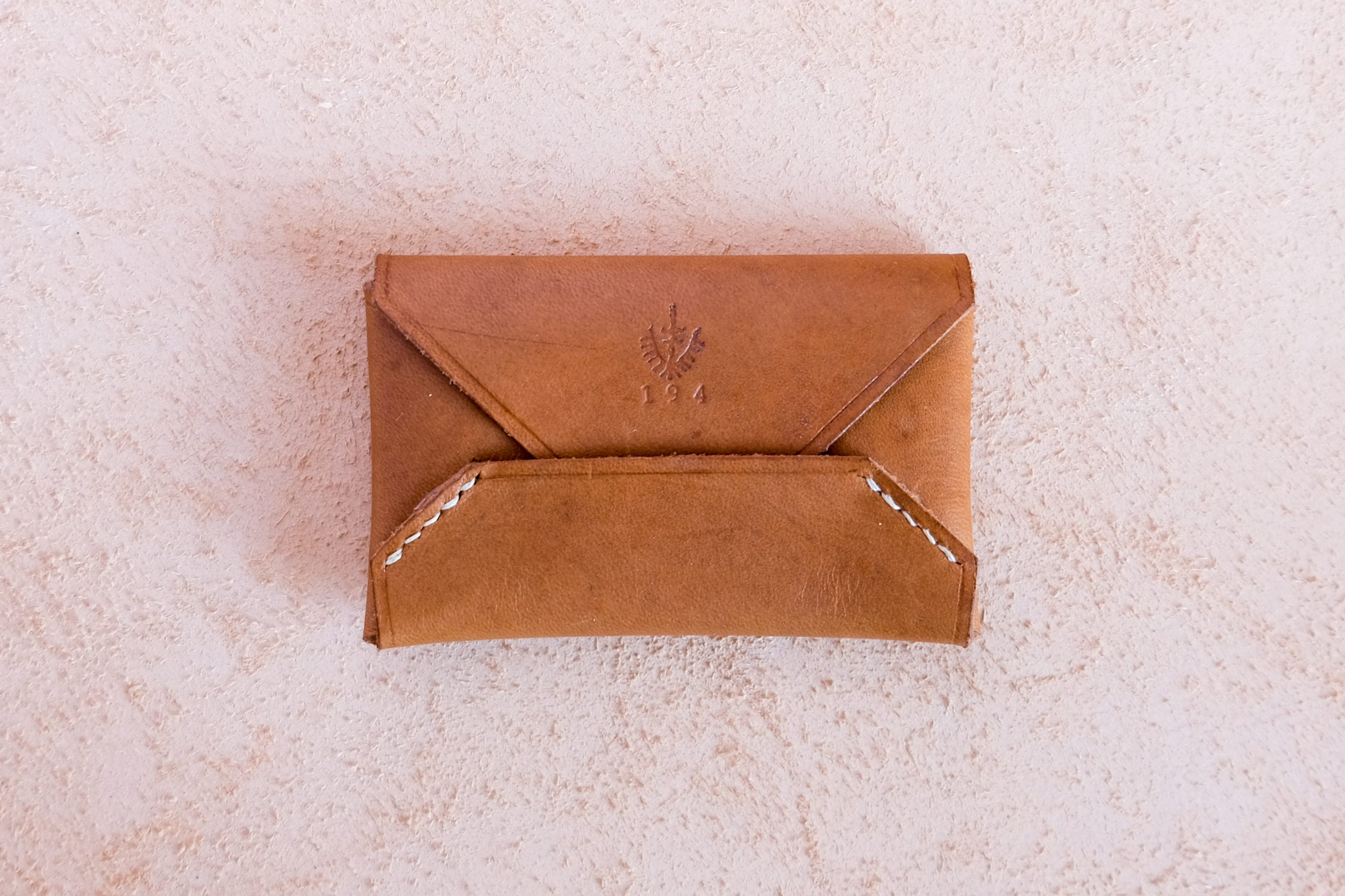 lerif designs leather business card holder airmail in walnut on beige background