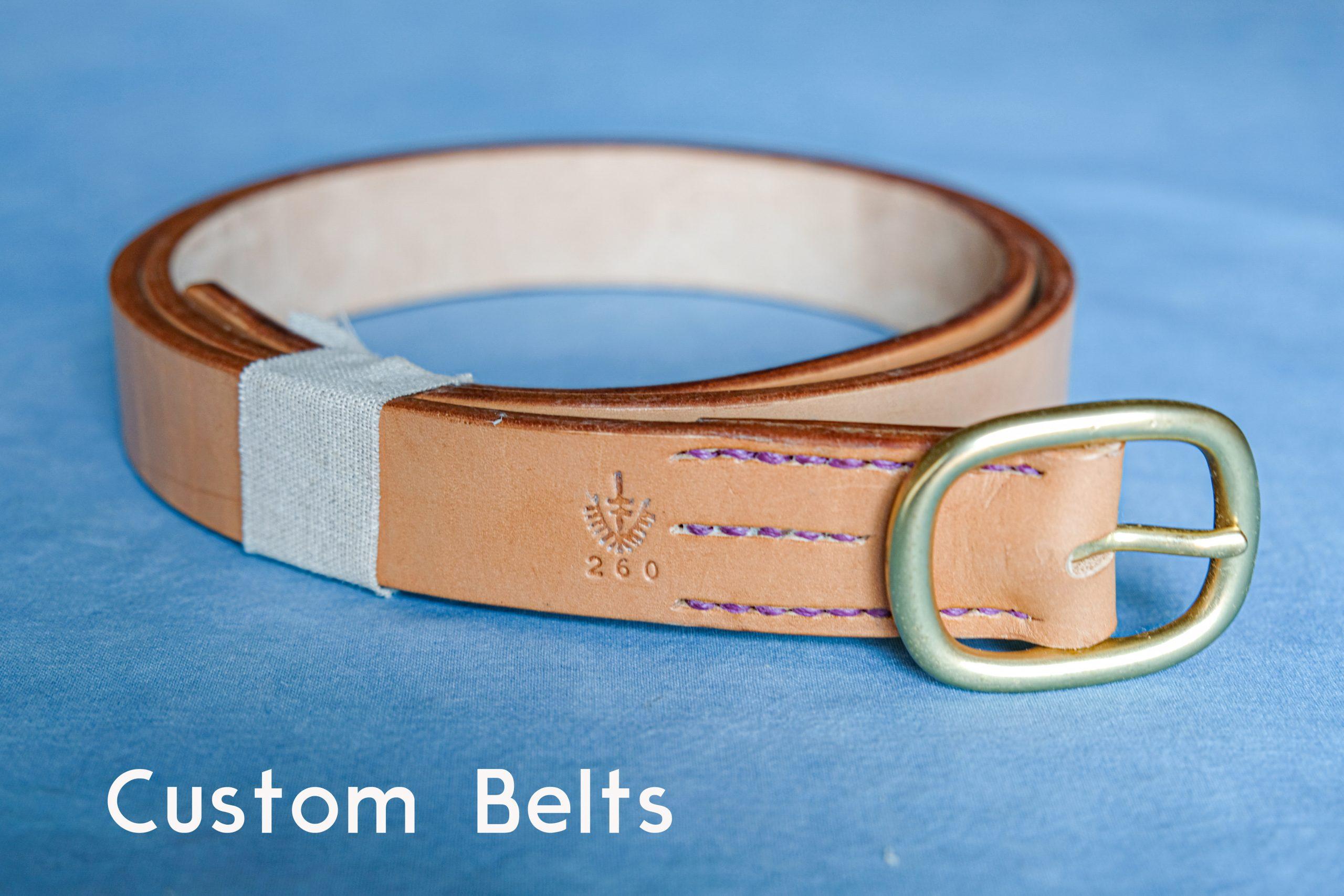 lerif designs custom leather belt with brass buckle on blue background