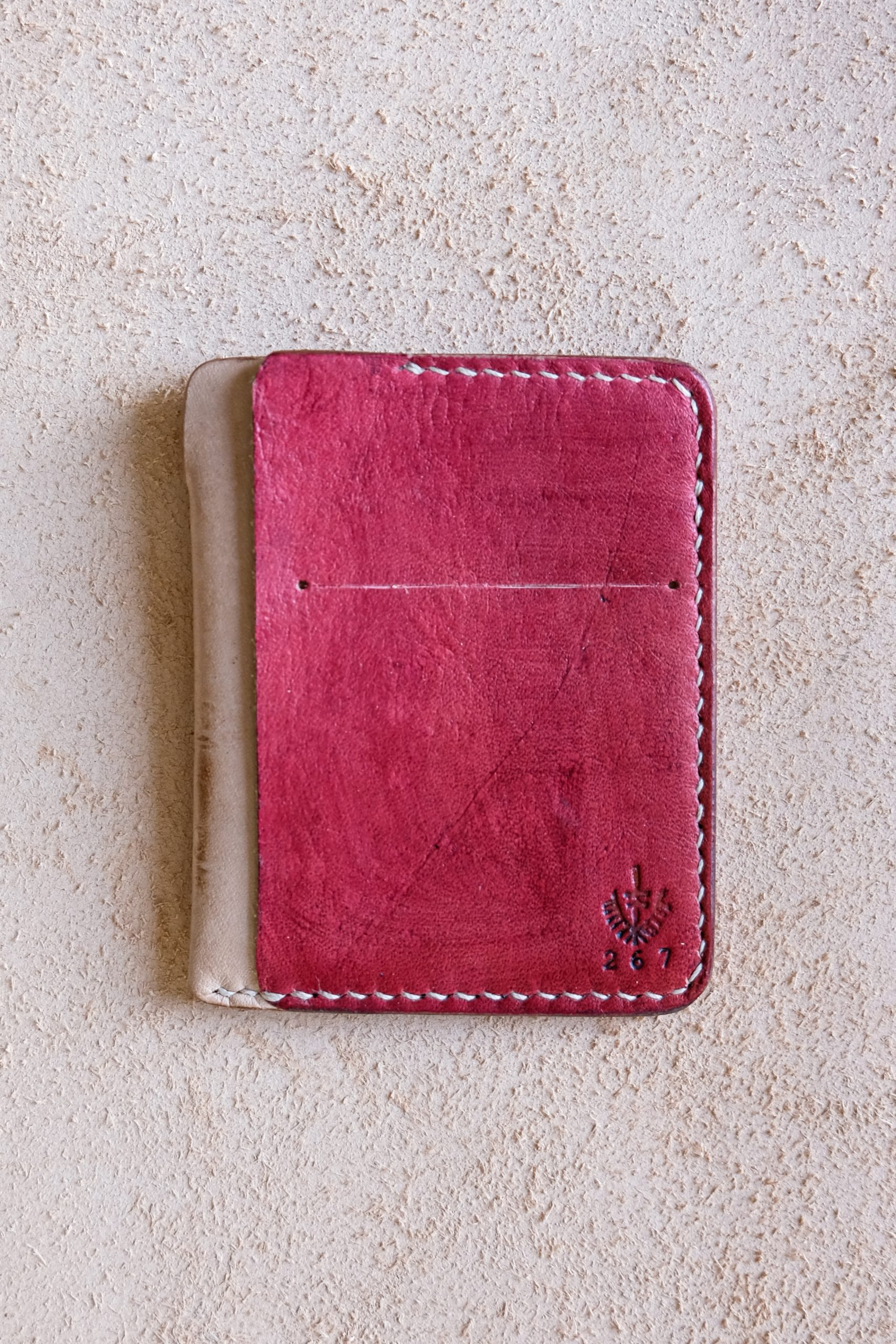 lerif designs vale leather wallet in cochineal on beige background