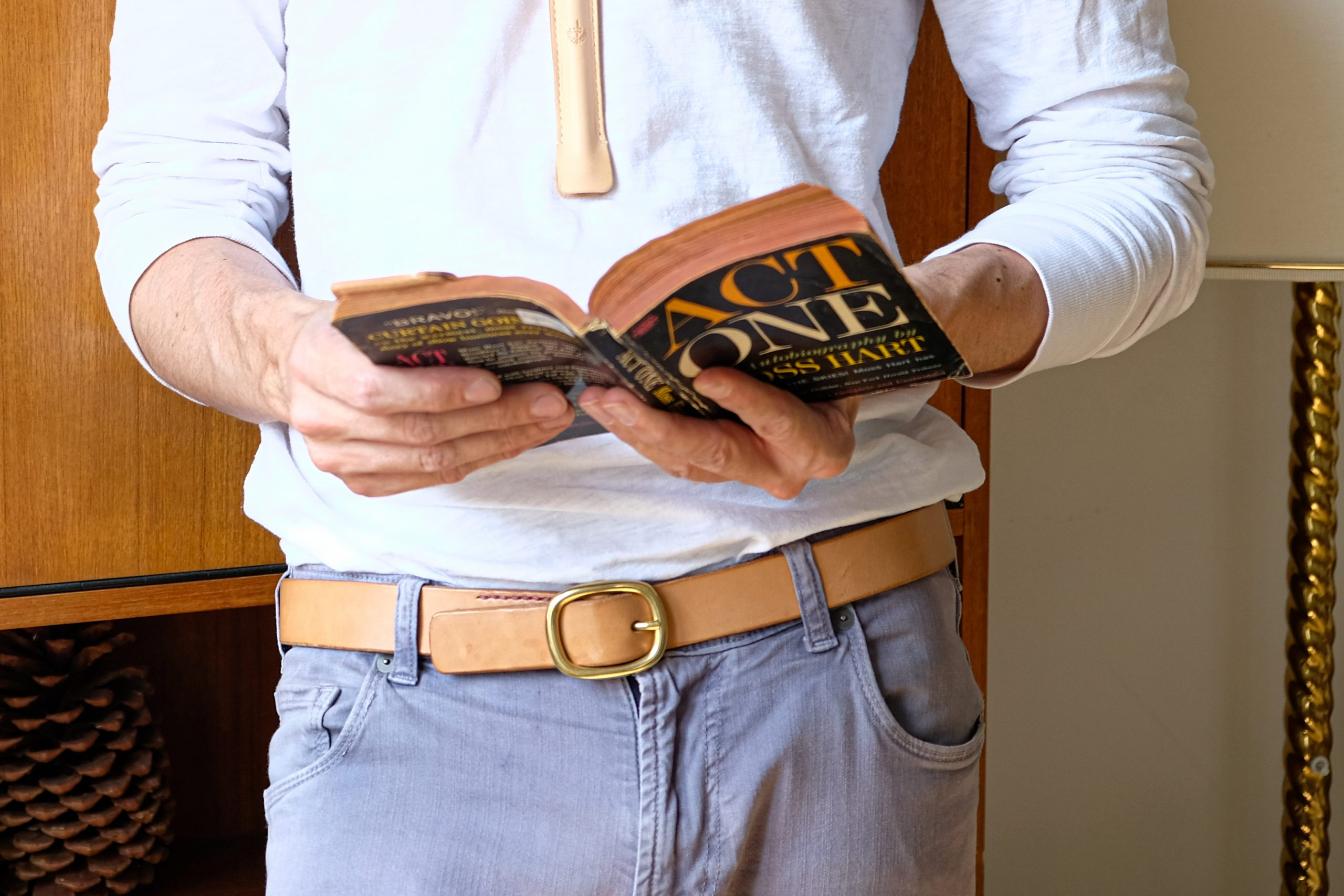 lerif designs custom leather forever belt with brass buckle on model reading a book